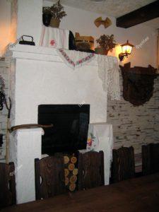 Печь в деревянном интерьере